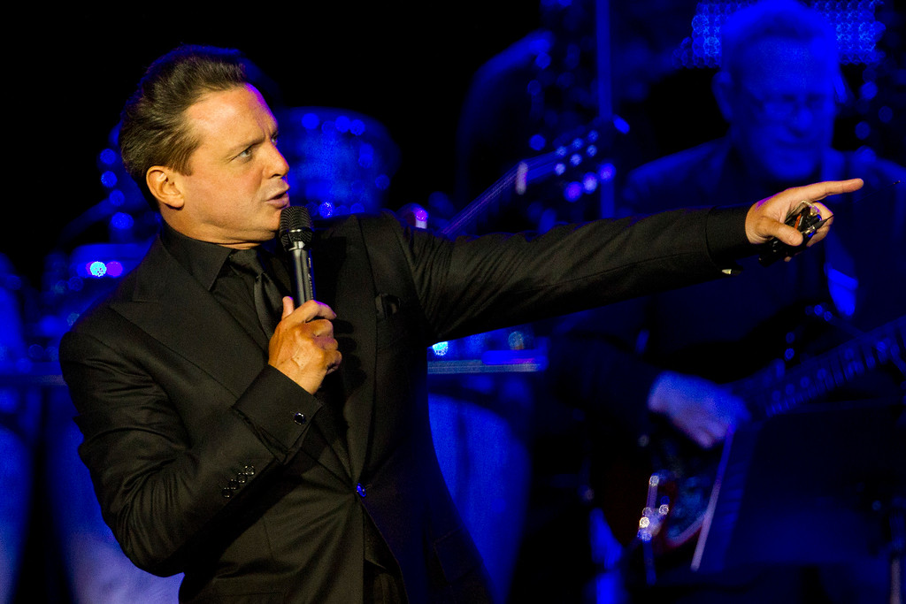 . FILE - In this March 11, 2012 file photo, Mexican singer Luis Miguel performs during a concert in Rio de Janeiro, Brazil. Authorities say Mexican singer Luis Miguel is in custody after he surrendered to U.S. marshals Tuesday in a case involving a dispute with his former manager.  (AP Photo/Felipe Dana, File)