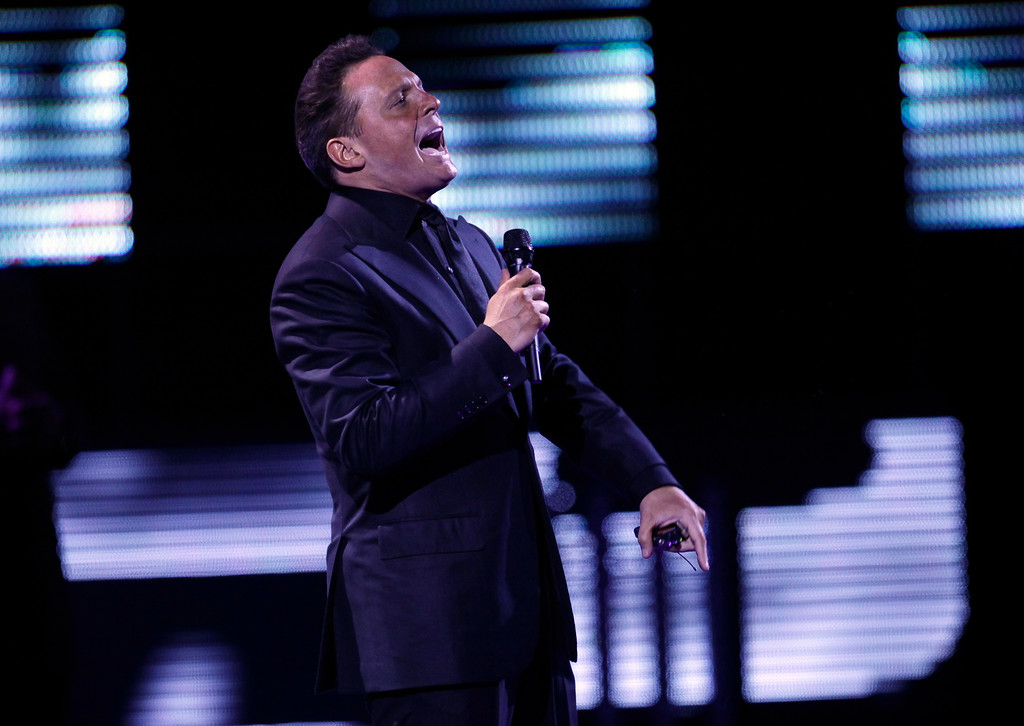 """. FILE - In this Feb. 22, 2012, file photo, Mexican singer Luis Miguel, known as \""""El Sol de Mexico,\"""" performs at the 53rd annual Vina del Mar International Song Festival, in Vina del Mar, Chile.  (AP Photo/Jorge Saenz, File)"""