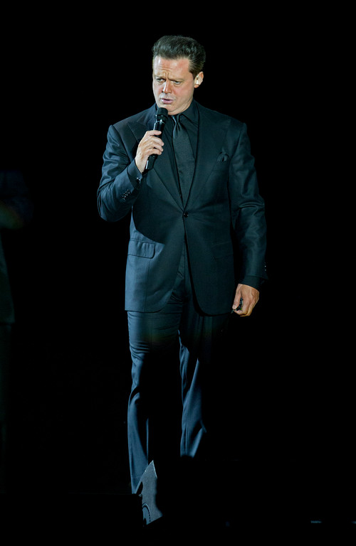 . Mexican singer Luis Miguel performs during a concert in Panama City, Tuesday, March 6, 2012. (AP Photo/Arnulfo Franco)