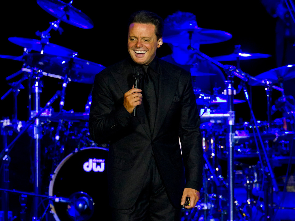 . FILE - This March 11, 2012 file photo, shows Mexican singer Luis Miguel performing at a concert in Rio de Janeiro, Brazil. Authorities say Mexican singer Luis Miguel is in custody after he surrendered to U.S. marshals Tuesday in a case involving a dispute with his former manager. (AP Photo/Felipe Dana, File)