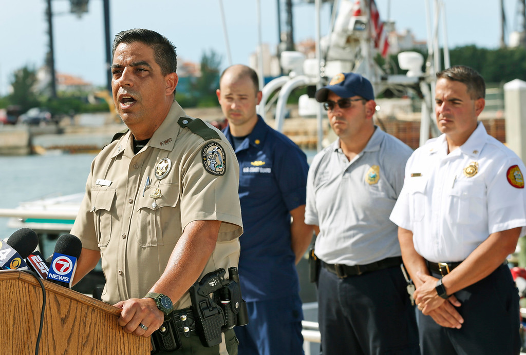 . Lorenzo Veloz, spokesman for the Florida Fish and Wildlife Conservation Commission, speaks during a news conference about a boating accident that killed Jose Fernandez, the ace right-hander for the Miami Marlins who escaped Cuba to become one of baseball\'s brightest stars, at U.S. Coast Guard Base Miami Beach, Sunday, Sept. 25, 2016, in Miami Beach, Fla. (AP Photo/Wilfredo Lee)