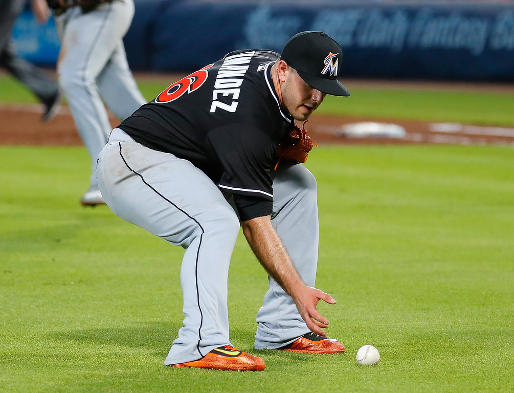 . ATLANTA, GA - SEPTEMBER 14:  Jose Fernandez #16 of the Miami Marlins scoops up a bunt single layed down by Julio Teheran #49 of the Atlanta Braves in the second inning at Turner Field on September 14, 2016 in Atlanta, Georgia.  (Photo by Kevin C. Cox/Getty Images)