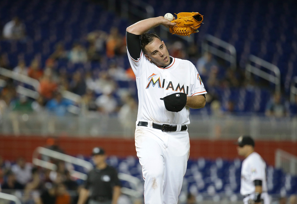 . Miami Marlins starting pitcher Jose Fernandez wipe his face while pitching during the fourth inning of an interleague baseball game against the Kansas City Royals, Wednesday, Aug. 24, 2016, in Miami. (AP Photo/Lynne Sladky)