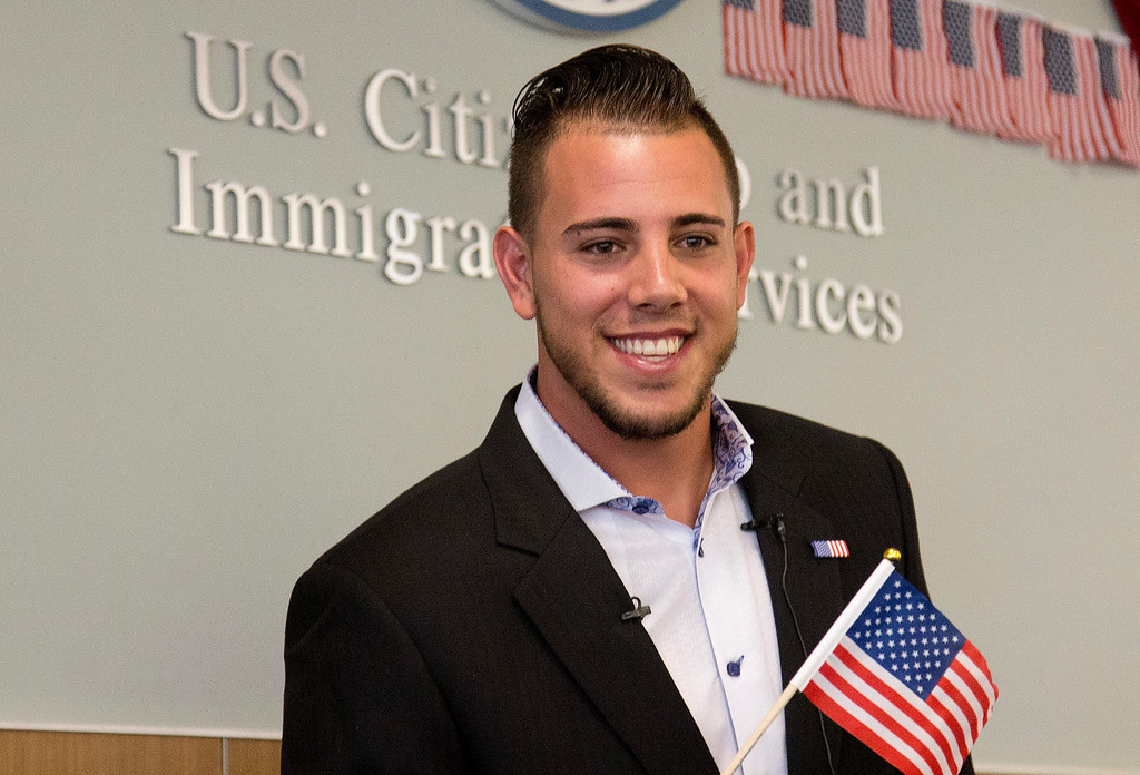 . FILE - In this Friday, April 24, 2015, file photo, Miami Marlins pitcher Jose Fernandez smiles after becoming a U.S. citizen during a naturalization ceremony in Miami. The Marlins announced Sunday, Sept. 25, 2016, that ace right-hander Fernandez has died. The U.S. Coast Guard says Fernandez was one of three people killed in a boat crash off Miami Beach early Sunday. (AP Photo/J Pat Carter, File)