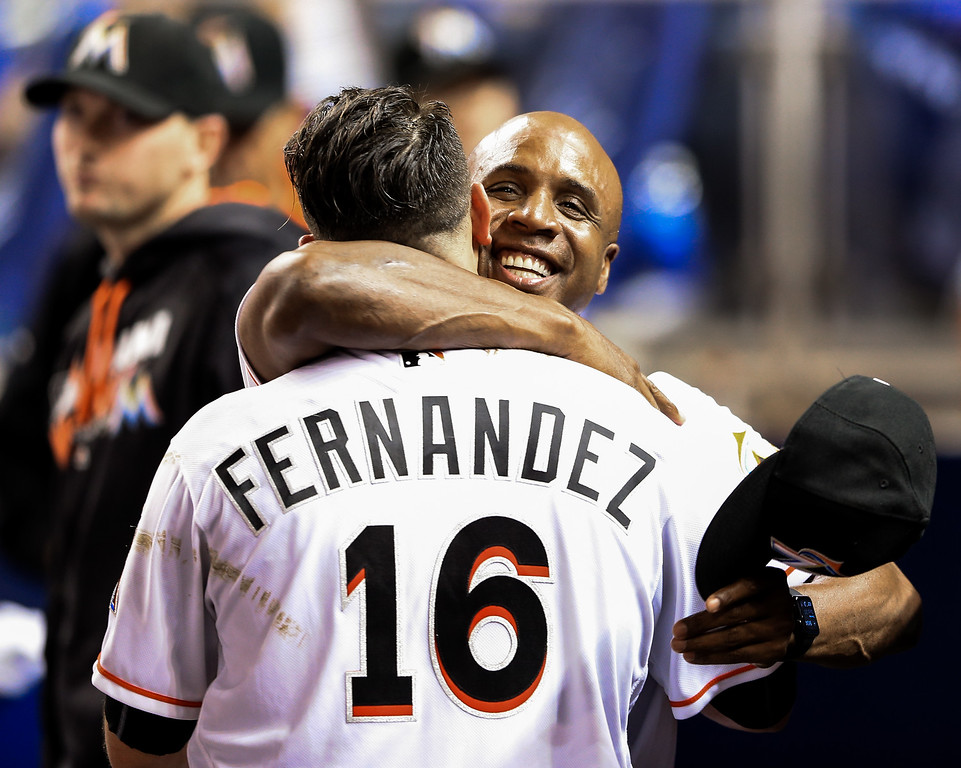 . MIAMI, FL - SEPTEMBER 20: Jose Fernandez #16 of the Miami Marlins celebrates in the dugout with hitting coach Barry Bonds during the game against the Washington Nationals at Marlins Park on September 20, 2016 in Miami, Florida. (Photo by Rob Foldy/Getty Images)