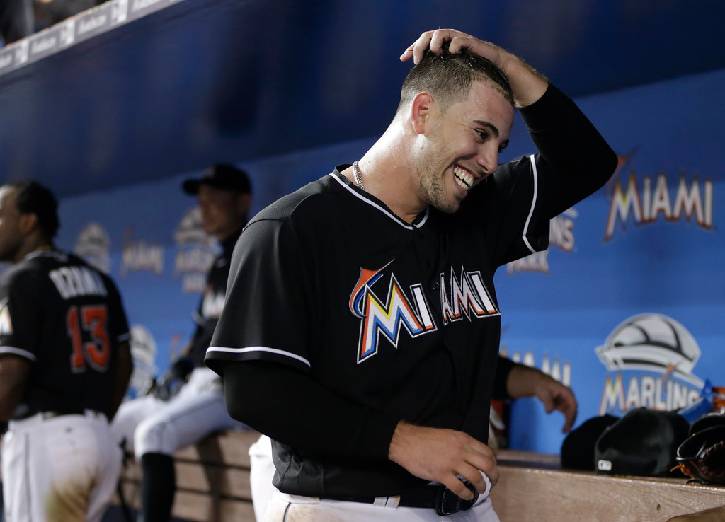 . Miami Marlins starting pitcher Jose Fernandez smiles in the dugout after pitching in the seventh inning of a baseball game against the New York Mets, Saturday, July 23, 2016, in Miami. (AP Photo/Lynne Sladky)