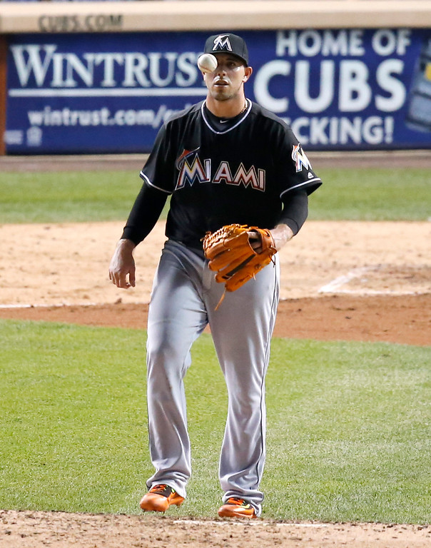 . Miami Marlins starting pitcher Jose Fernandez tosses the ball up after loading the bases with a walk to Chicago Cubs\' Anthony Rizzo during the fifth inning of a baseball game Tuesday, Aug. 2, 2016, in Chicago. (AP Photo/Charles Rex Arbogast)