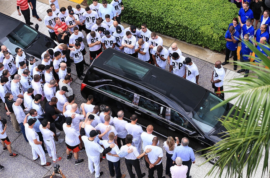 """. Miami Marlins players and members of the Marlins organization and their fans surround the hearse carrying Miami Marlins pitcher Jose Fernandez to pay their respects on September 28, 2016 in Miami, Florida. Fernandez was the \""""probable\"""" operator of the speeding boat that crashed into a Miami Beach jetty on Sept. 25, 2016, killing the baseball star and two other men, according to a report issued Thursday, March 16, 2017, by the Florida Fish and Wildlife Conservation Commission, which investigated the accident. (Photo by Rob Foldy/Getty Images)"""