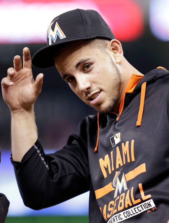 . FILE - In this Monday, June 1, 2015, file photo, Miami Marlins pitcher Jose Fernandez replaces his cap after the singing of the national anthem before the start of a baseball game between the Miami Marlins and the Chicago Cubs, in Miami. The Marlins announced Sunday, Sept. 25, 2016, that ace right-hander Fernandez has died. The U.S. Coast Guard says Fernandez was one of three people killed in a boat crash off Miami Beach early Sunday. (AP Photo/Wilfredo Lee, File)