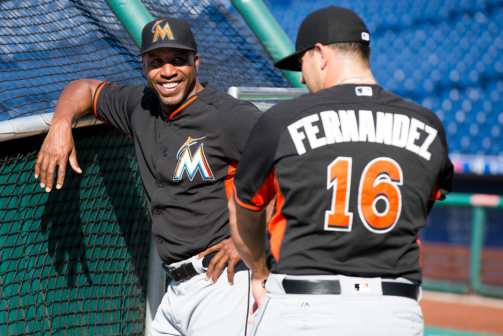 . Miami Marlins hitting coach Barry Bonds, left, talks with Jose Fernandez, right, during warm-ups prior to the first inning of a baseball game against the Philadelphia Phillies, Thursday, July 21, 2016, in Philadelphia. (AP Photo/Chris Szagola)