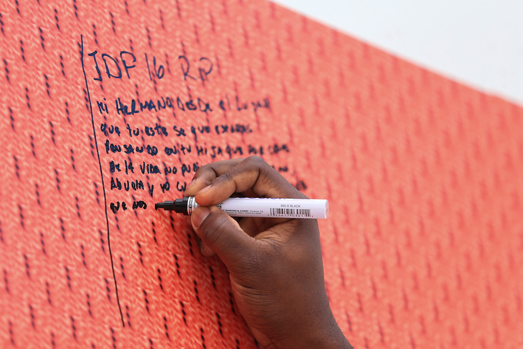 . MIAMI, FL - SEPTEMBER 28: Marcell Ozuna of the Miami Marlins signs a memorial wall after the hearse carrying Miami Marlins pitcher Jose Fernandez passed in front of the Marlins baseball stadium on September 28, 2016 in Miami, Florida. Mr. Fernandez was killed in a weekend boat crash in Miami Beach along with two friends.  (Photo by Rob Foldy/Getty Images)