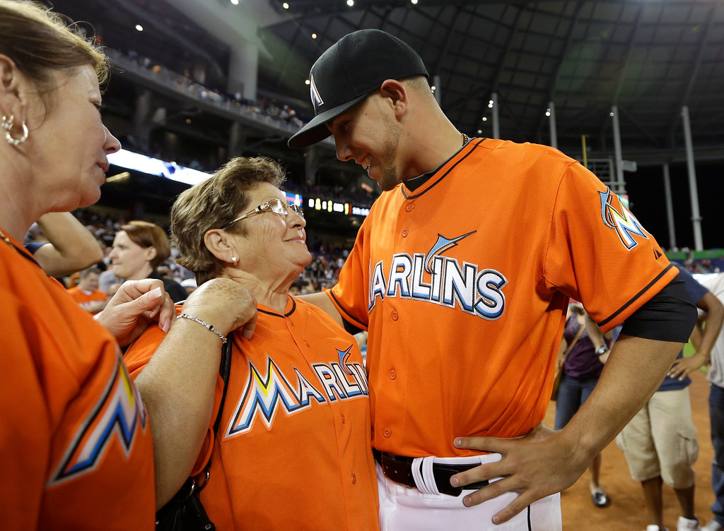 . Miami Marlins starting pitcher Jose Fernandez, right, talks with his grandmother Olga Fernandez, of Cuba, center, and mother Maritza Fernandez, left, of Miami, following the Marlins\' 10-1 victory over the Colorado Rockies in an opening day baseball game, Monday, March 31, 2014, in Miami. (AP Photo/Lynne Sladky)