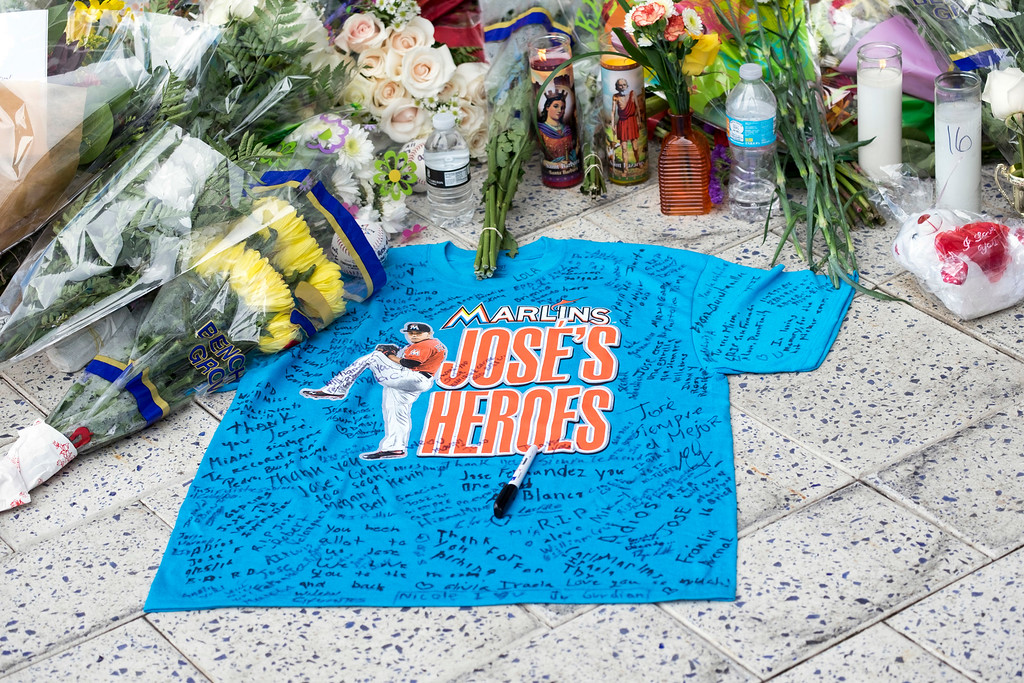 . A remembrance shirt at a makeshift memorial in honor of Jose Fernandez sits outside Marlins Park, Sunday, Sept. 25, 2016. Jose Fernandez, the ace right-hander for the Miami Marlins who escaped Cuba to become one of baseball\'s brightest stars, was killed in a boating accident early Sunday morning. Fernandez was 24. (AP Photo/Gaston De Cardenas)