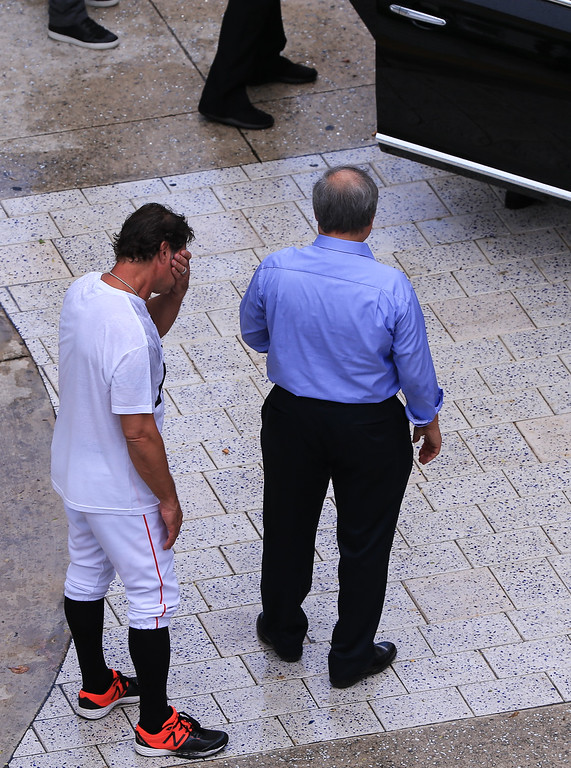 . MIAMI, FL - SEPTEMBER 28: Miami Marlins owner Jeffrey Loria, right, and manager Don Mattingly, left, await the late Jose Fernandez\' mother Maritza Fernandez as Miami Marlins players and members of the Marlins organization and their fans surround the hearse carrying Miami Marlins pitcher Jose Fernandez to pay their respects on September 28, 2016 in Miami, Florida. Mr. Fernandez was killed in a weekend boat crash in Miami Beach along with two friends. (Photo by Rob Foldy/Getty Images)