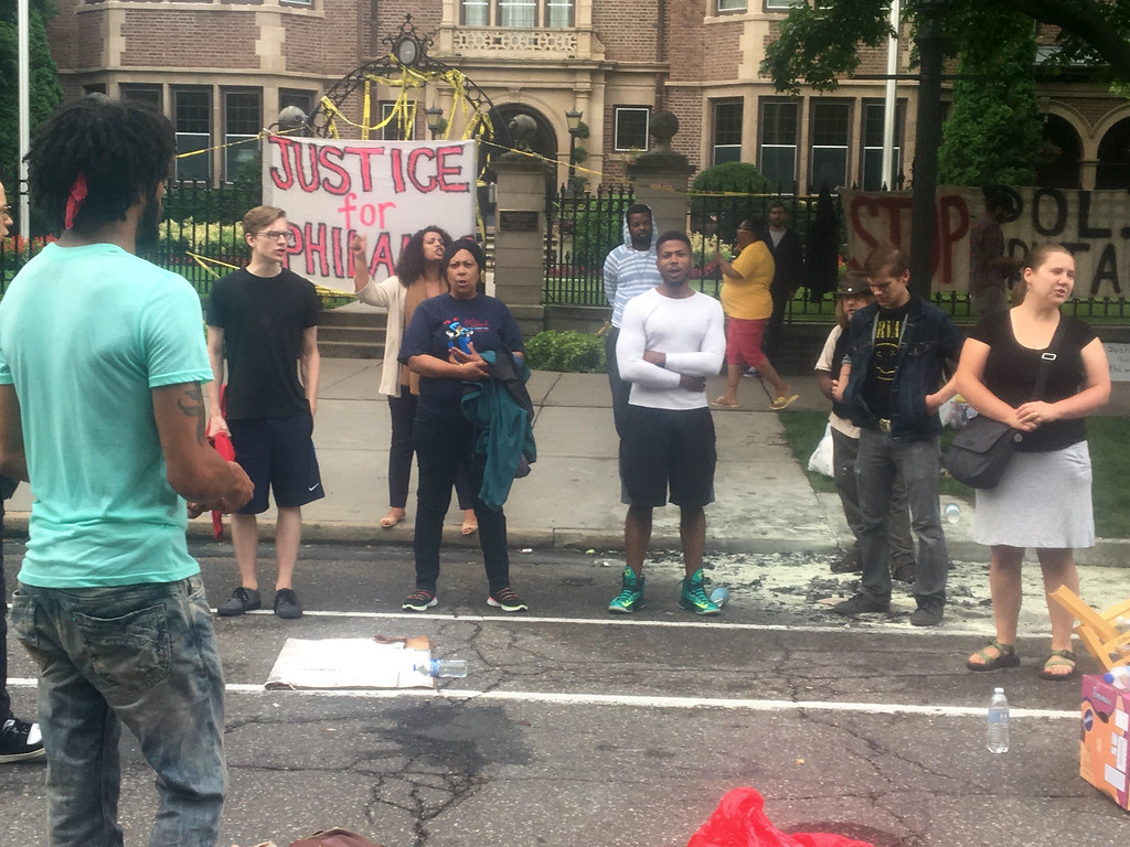 . About 200 people gathered outside the Minnesota Governor\'s Residence in St. Paul, Thursday, July 7, 2016, protesting the fatal shooting of a man by a suburban police officer. Philando Castile was shot in a car Wednesday night in the largely middle-class St. Paul suburb of Falcon Heights. Police have said the incident began when an officer initiated a traffic stop in suburban Falcon Heights but have not further explained what led to the shooting.  (AP Photo/Jeff Baenen)