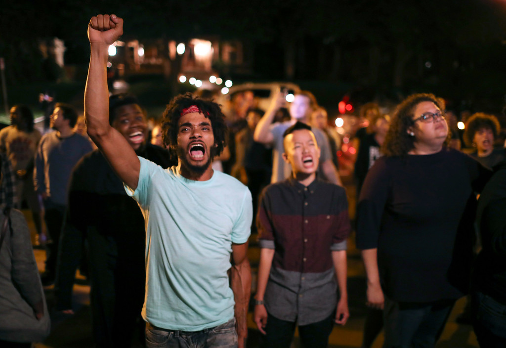 . Angry demonstrators chant as they block Summit Ave in front of the Governor\'s Residence in St. Paul, Minn., early Thursday morning, July 7, 2016.  Philando Castile was shot in a car Wednesday night in the largely middle-class St. Paul suburb of Falcon Heights. Police have said the incident began when an officer initiated a traffic stop in suburban Falcon Heights but have not further explained what led to the shooting. (Jeff Wheeler/Star Tribune via AP)