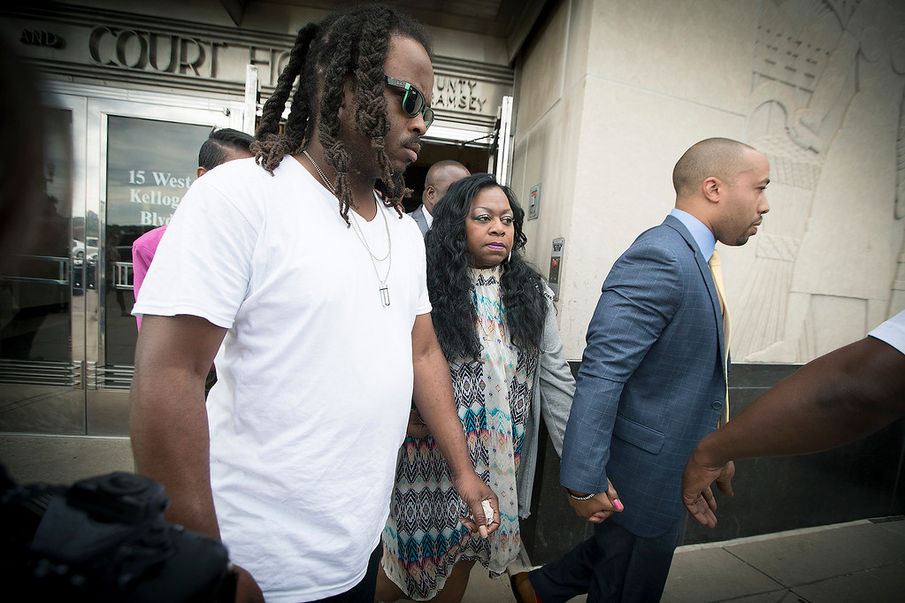 . Family and friends surround Valerie Castile, the mother Philando Castile as she walked out of the courthouse after Geronimo Yanez was found not guilty on all counts in the shooting death of Philander Castile, Friday, June 16, 2017 in  St. Paul, Minn. (Elizabeth Flores/Star Tribune via AP)