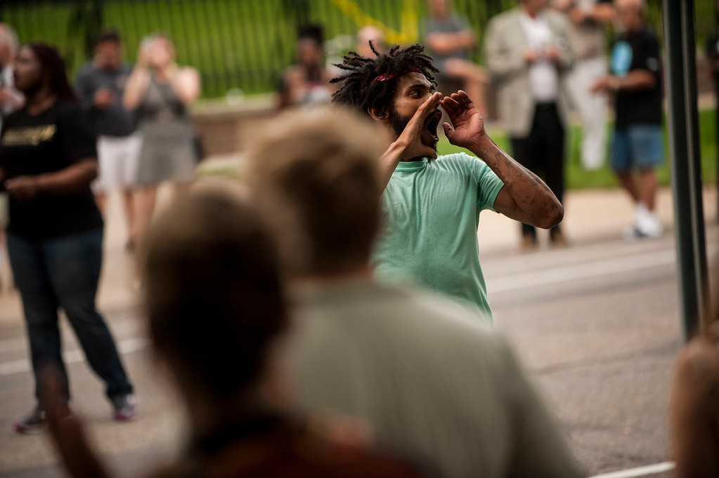 . ST. PAUL, MN - JULY 07: Jacob Ladda leads a chant for Philando Castile outside Governor\'s Mansion on July 7, 2016 in St. Paul, Minnesota. Castile was shot and killed last night, July 6, 2016, by a police officer in Falcon Heights, MN. (Photo by Stephen Maturen/Getty Images)