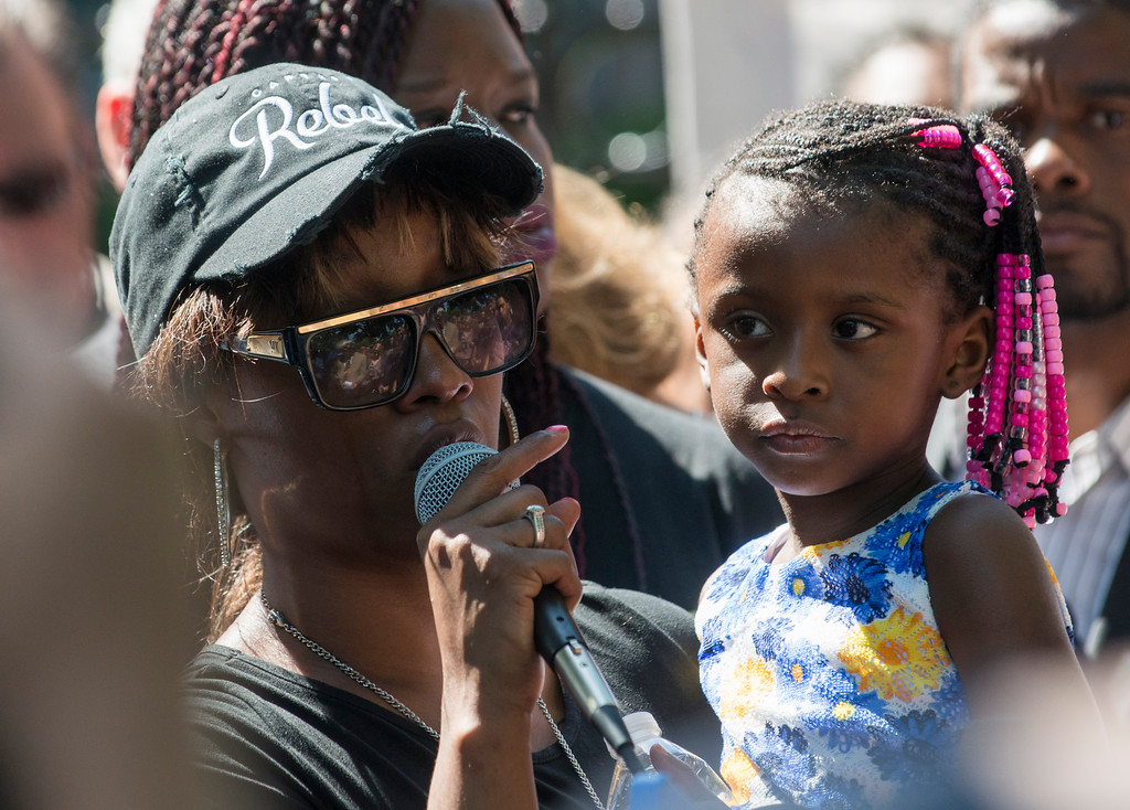. ST. PAUL, MN - JULY 07: Diamond Reynolds, holding her daughter, speaks to a crowd outside the Governor\'s Mansion on July 7, 2016 in St. Paul, Minnesota. Reynolds live streamed video of her boyfriend Philando Castile after he was shot by a police officer on the night of July 6th, 2016. (Photo by Stephen Maturen/Getty Images)