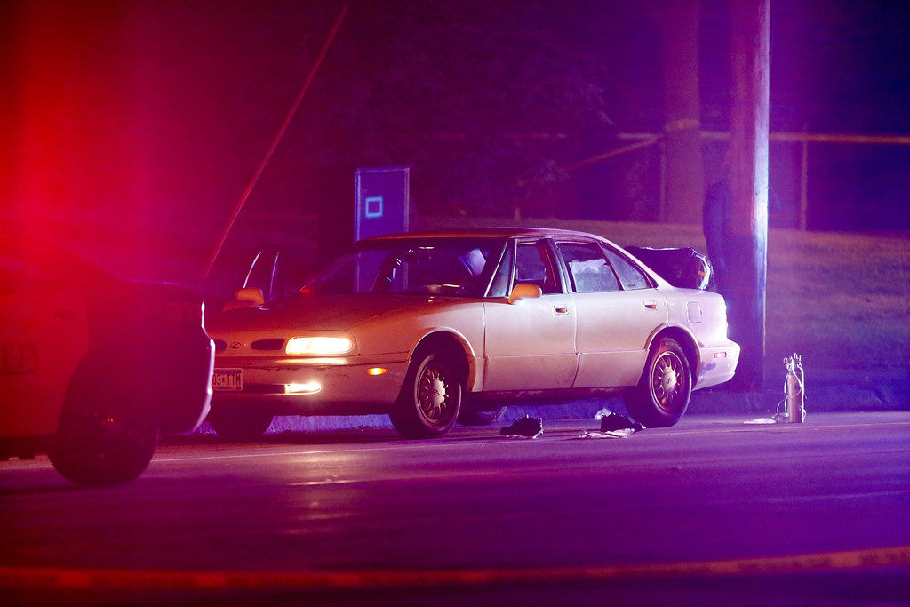 . A car at the scene of a shooting of a man involving a St. Anthony Park Police officer Wednesday, July 6, 2016, in Falcon Heights, Minn. Police in Minnesota say a man has been taken to a hospital in unknown condition after being shot by an officer while inside a car with a woman and a child. St. Anthony Police interim police chief Jon Mangseth told reporters at a news conference that the incident began when an officer from his agency initiated a traffic stop around 9 p.m. Wednesday in Falcon Heights, a St. Paul suburb. (Leila Navidi/Star Tribune via AP)