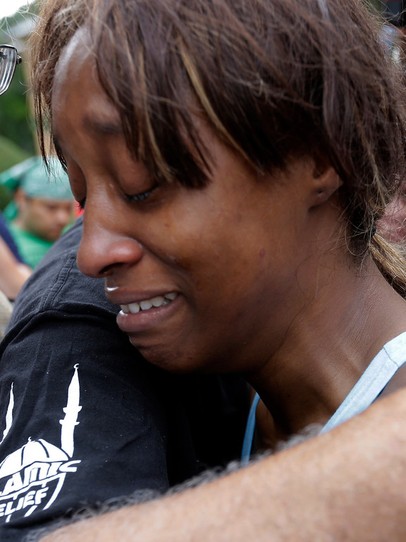 . Diamond Reynolds, the girlfriend of Philando Castile of St. Paul, is consoled Thursday, July 7, 2016 outside the governor\'s residence in St. Paul, Minn.  Castile was shot and killed after a traffic stop by St. Anthony police in Falcon Heights, Minn. Wednesday night. A video shot by Reynolds of the shooting( went viral. AP Photo/Jim Mone)