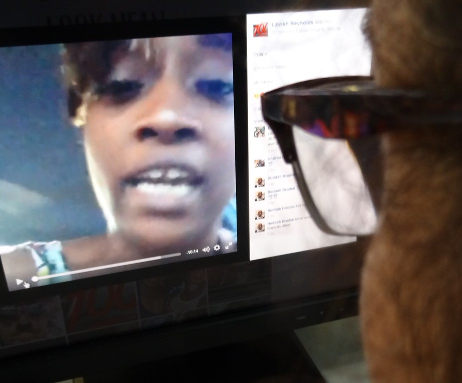 . An editor watches a video on July 7, 2016 in Washington, DC, showing the dying moments of a black man man shot by Minnesota police after being pulled over while driving.  A woman, identified on her Facebook page as Lavish Reynolds, livestreamed her boyfriend\'s dying moments after a new police shooting a day after a similar event in Louisiana. Police confirmed the shooting by an officer. Family and activists identified the victim as school cafeteria worker Philando Castile, 32. Castile can be seen in the driver seat, large blood stains spreading through his white shirt. Reynolds sat next to him and her young daughter was also traveling in the car.  (STF/AFP/Getty Images)