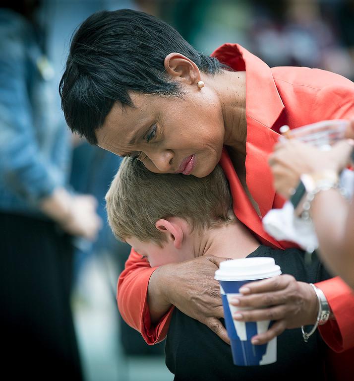 . Judge Glenda Hatchett was hugged by Philando Castile supporter Guthrie Morgan, 7, after Geronimo Yanez was found not guilty on all counts in the shooting death of Philander Castile, Friday, June 16, 2017 in St. Paul, Minn. (Elizabeth Flores/Star Tribune via AP)