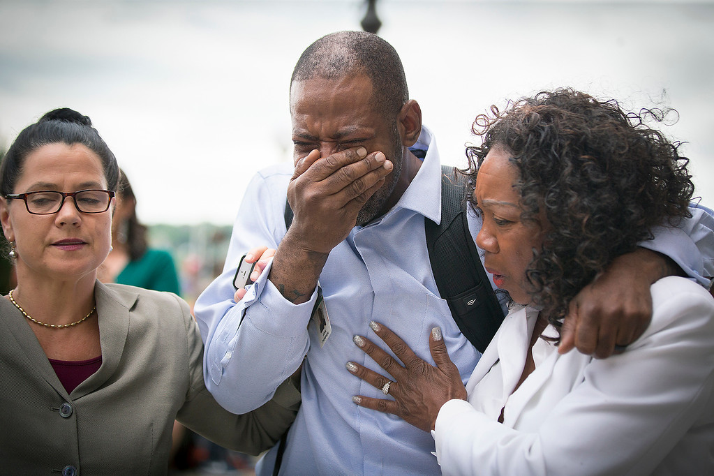 . Family and friends of Valerie Castile and Philando Castile, including John Thompson, center, wept as he walked out of the courthouse after Geronimo Yanez was found not guilty on all counts in the shooting death of Philander Castile, Friday, June 16, 2017 in St. Paul, Minn. (Elizabeth Flores/Star Tribune via AP)
