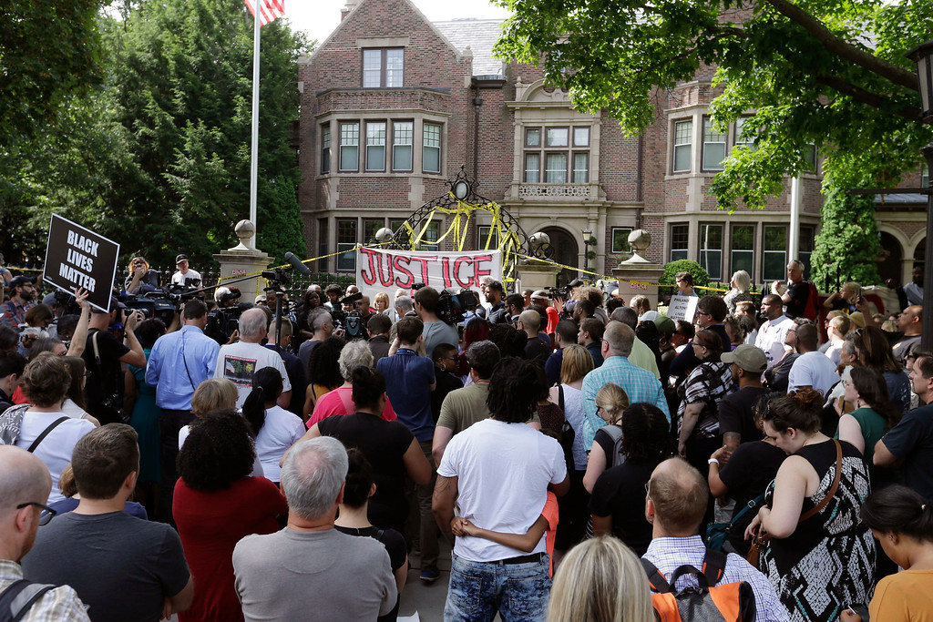 . Protesters gather outside the governor\'s residence Thursday, July 7, 2016, in St. Paul, Minn. A police officer fatally shot Philando Castile as a woman in the vehicle apparently livestreamed the aftermath in a widely shared Facebook video. The shooting happened late Wednesday during a traffic stop in the St. Paul suburb of Falcon Heights. (AP Photo/Jim Mone)