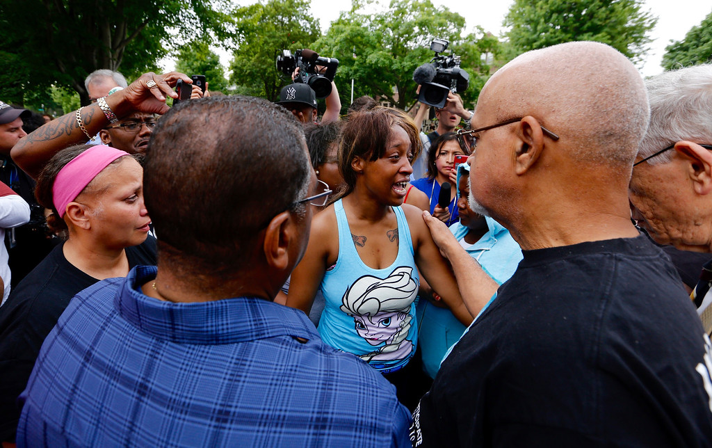 . Diamond Reynolds, girlfriend of Philando Castile, is consoled after speaking to a crowd outside the governor\'s residence in St. Paul, Thursday, July 7, 2016. Philando Castile was shot by police in a car Wednesday night in the St. Paul suburb of Falcon Heights. Police have said the incident began when an officer initiated a traffic stop in suburban Falcon Heights but have not further explained what led to the shooting. (Leila Navidi/Star Tribune via AP)