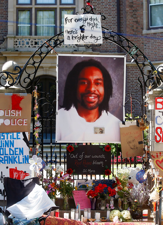 . FILE - In this July 25, 2016, file photo, a memorial including a photo of Philando Castile adorns the gate to the governor\'s residence  in St. Paul, Minn.  On Friday, June 16, 2017, Jeronimo Yanez was acquitted in the killing of Castile, a black motorist, that drew widespread attention when video of the shooting\'s aftermath was streamed live. (AP Photo/Jim Mone, File)