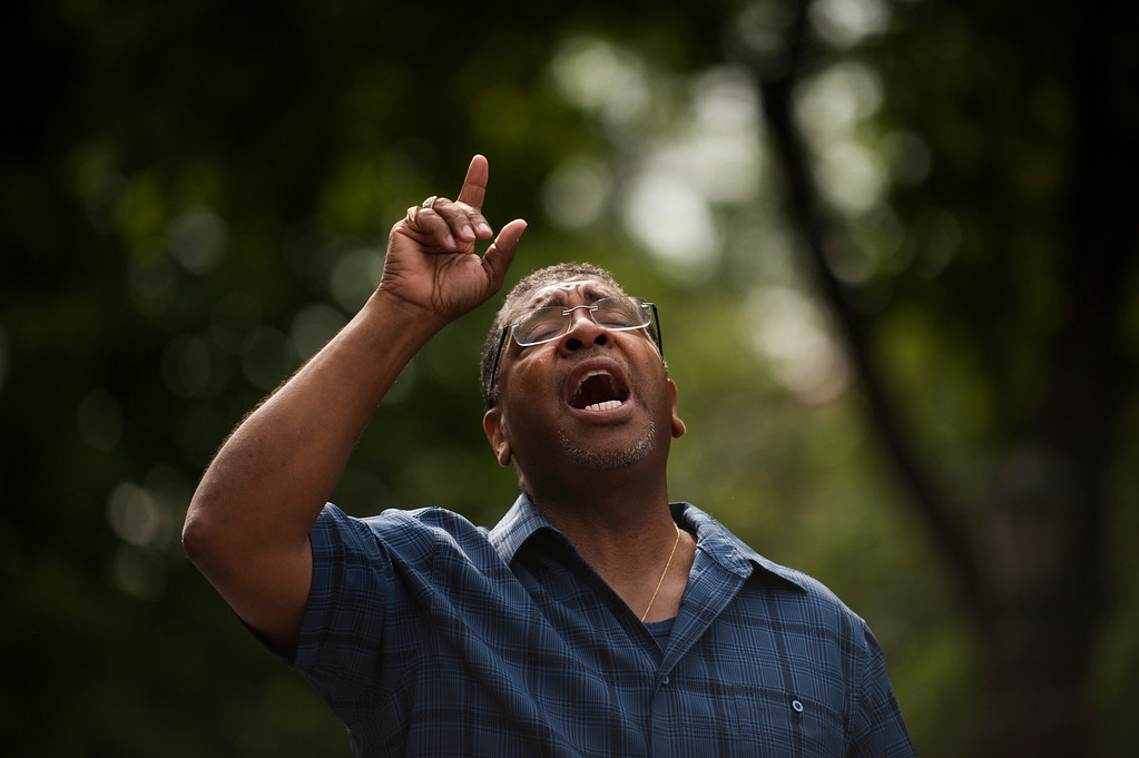 . ST. PAUL, MN - JULY 07: Pastor Brian Heron leads a prayer for Philando Castile outside Governor\'s Mansion on July 7, 2016 in St. Paul, Minnesota. Castile was shot and killed last night, July 6, 2016, by a police officer in Falcon Heights, MN. (Photo by Stephen Maturen/Getty Images)