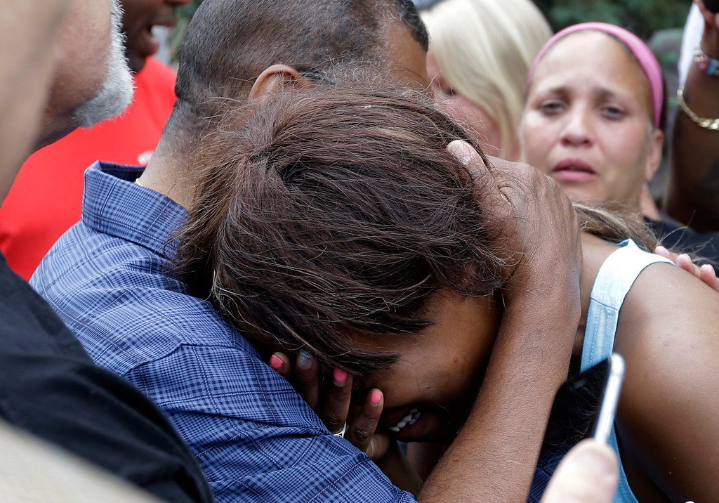 . Diamond Reynolds, the girlfriend of Philando Castile is consoled by a minister outside the governor\'s residence in St. Paul, Minn., on Thursday, July 7, 2016.   Castile was shot and killed after a traffic stop by police in Falcon Heights, Wednesday night. A video shot by Reynolds of the shooting  went viral.  (AP Photo/Jim Mone)