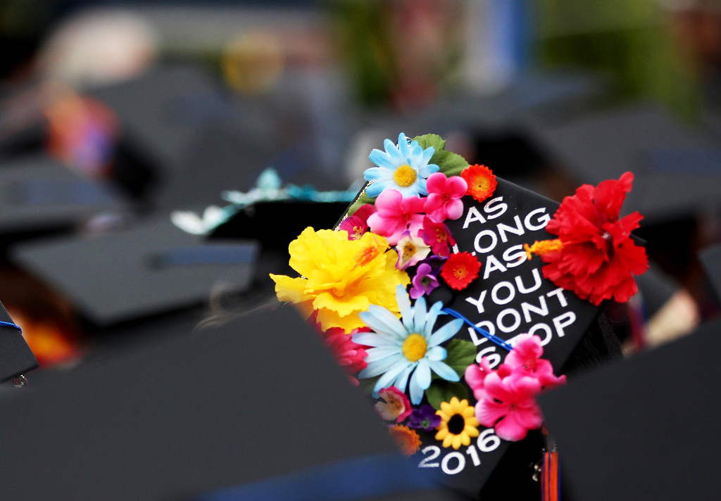 . Students decorated their mortar boards for Citrus Community College\'s 2016 commencement ceremony at Citrus College in Glendora, Calif. on Saturday, June 11, 2016. (Correspondent photo by Trevor Stamp)