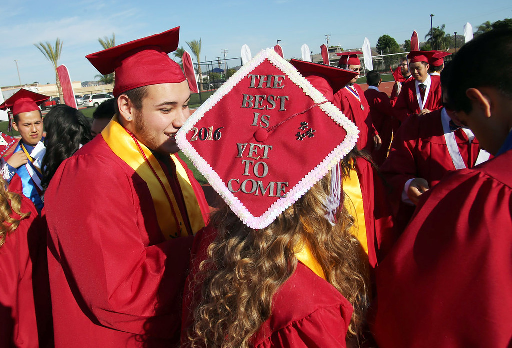 . A Covina High School graduates decorates her graduation cap for the 2016 Covina High School Graduation, at District Field at Covina High School in Covina, CA., Monday, June 6, 2016.  (Photo by James Carbone for the San Gabriel Valley Tribune)