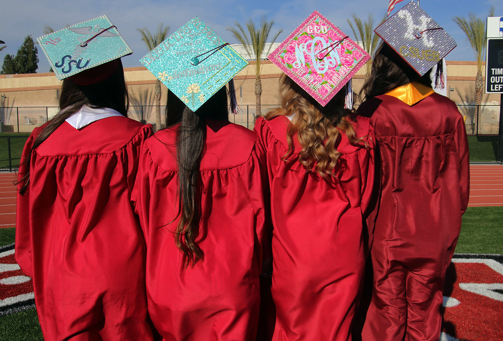 . Covina High School graduates decorate their graduation caps for the 2016 Covina High School Graduation, at District Field at Covina High School in Covina, CA., Monday, June 6, 2016.  (Photo by James Carbone for the San Gabriel Valley Tribune)