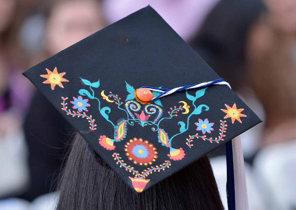 . Stephanie Martinez decorated the top of her mortar board. Martinez was one of the few student award winners who wore a cap and gown. The Cal State University Northridge Honors Convocation, recognizing outstanding graduating students, took place on the Oviatt Library Lawn. Northridge, CA.  May 20, 2016. (Photo by John McCoy/Southern California News Group
