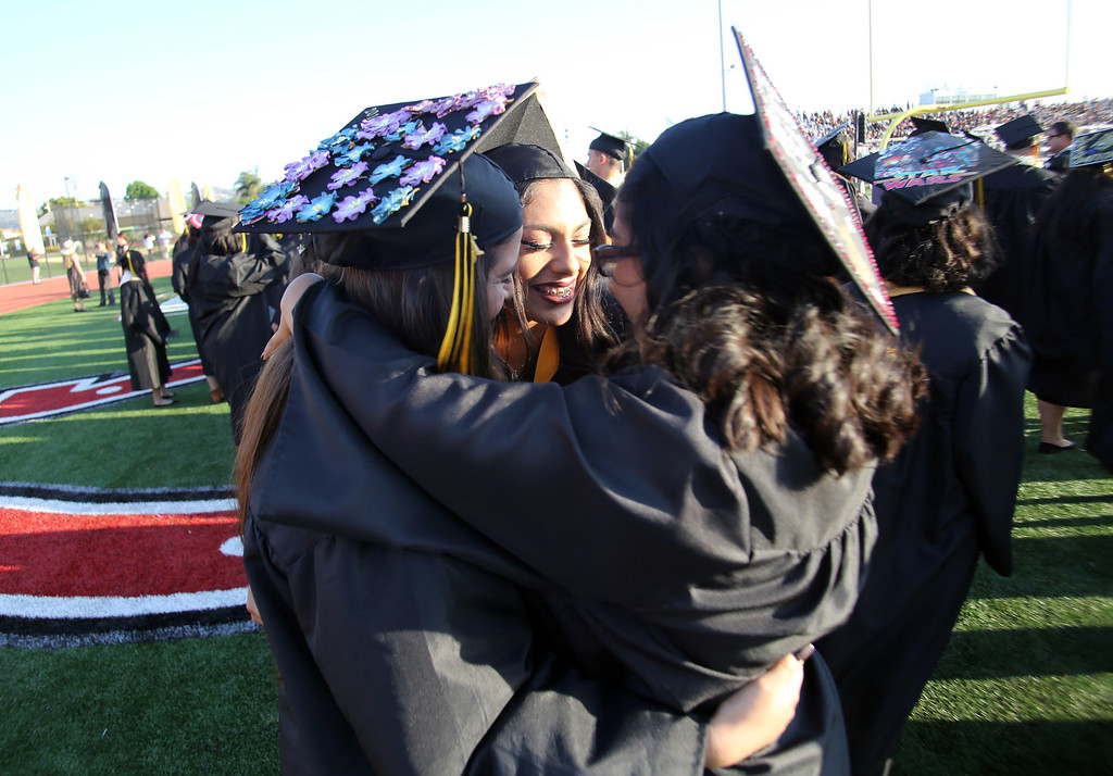 . A few Northview High School graduates take a moment for a hug, moments before the 2016 Northview High School Fifty-Fourth Annual Commencement, at Covina District Field, at Covina High School in Covina, CA., Tuesday, June 7, 2016.  (Photo by James Carbone for the San Gabriel Valley Tribune)