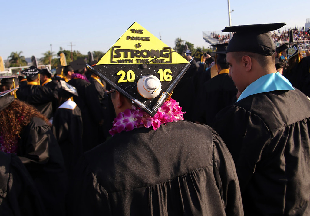 . A Northview High School graduate decorates his cap with a positive message, during the 2016 Northview High School Fifty-Fourth Annual Commencement, at Covina District Field, at Covina High School in Covina, CA., Tuesday, June 7, 2016.  (Photo by James Carbone for the San Gabriel Valley Tribune)