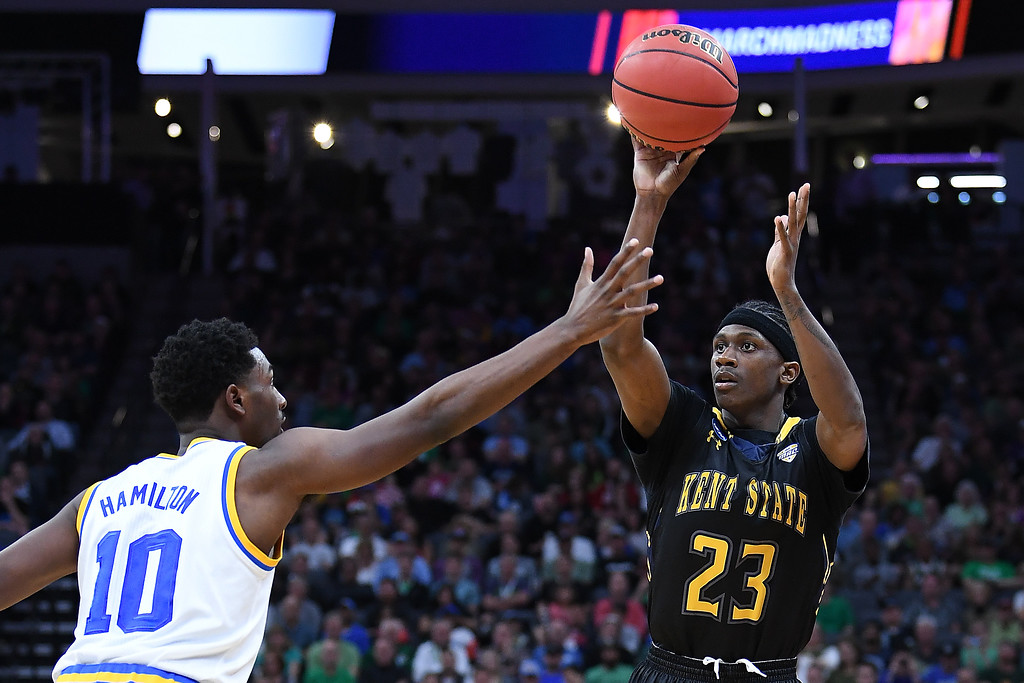 . SACRAMENTO, CA - MARCH 17: Jaylin Walker #23 of the Kent State Golden Flashes attempts a shot against Isaac Hamilton #10 of the UCLA Bruins during the first round of the 2017 NCAA Men\'s Basketball Tournament at Golden 1 Center on March 17, 2017 in Sacramento, California.  (Photo by Thearon W. Henderson/Getty Images)