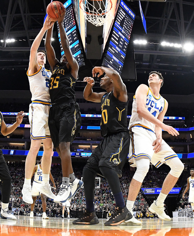 . SACRAMENTO, CA - MARCH 17: TJ Leaf #22 of the UCLA Bruins and Jimmy Hall #35 of the Kent State Golden Flashes battle for the rebound during the first round of the 2017 NCAA Men\'s Basketball Tournament at Golden 1 Center on March 17, 2017 in Sacramento, California.  (Photo by Thearon W. Henderson/Getty Images)