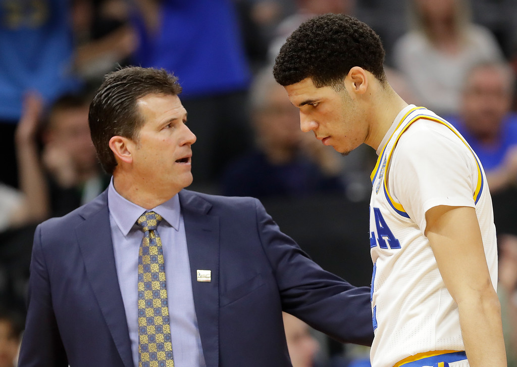 . SACRAMENTO, CA - MARCH 17:  Lonzo Ball #2 is congratulated by his Head coach Steve Alford of the UCLA Bruins as his team defeats the Kent State Golden Flashes during the first round of the 2017 NCAA Men\'s Basketball Tournament at Golden 1 Center on March 17, 2017 in Sacramento, California.  (Photo by Jamie Squire/Getty Images)