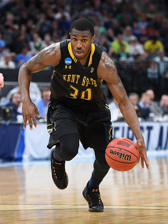 . SACRAMENTO, CA - MARCH 17: Deon Edwin #30 of the Kent State Golden Flashes handles the ball on offense against the UCLA Bruins during the first round of the 2017 NCAA Men\'s Basketball Tournament at Golden 1 Center on March 17, 2017 in Sacramento, California.  (Photo by Thearon W. Henderson/Getty Images)