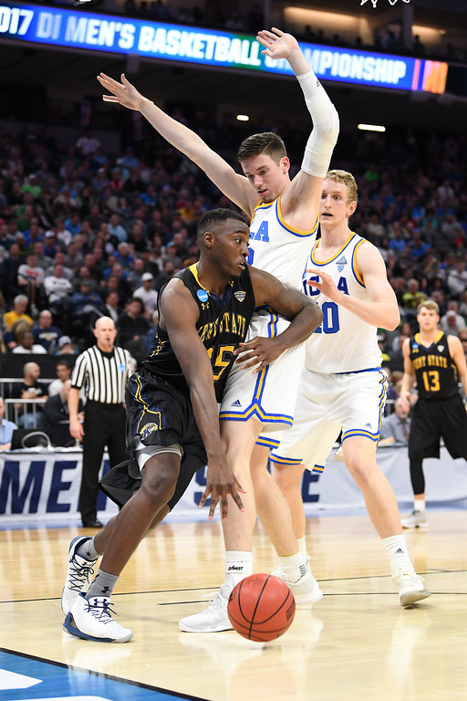 . SACRAMENTO, CA - MARCH 17: Jimmy Hall #35 of the Kent State Golden Flashes is defended by TJ Leaf #22 of the UCLA Bruins during the first round of the 2017 NCAA Men\'s Basketball Tournament at Golden 1 Center on March 17, 2017 in Sacramento, California.  (Photo by Thearon W. Henderson/Getty Images)