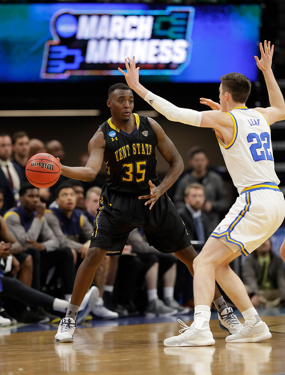 . SACRAMENTO, CA - MARCH 17:  Jimmy Hall #35 of the Kent State Golden Flashes is defended by TJ Leaf #22 of the UCLA Bruinsduring the first round of the 2017 NCAA Men\'s Basketball Tournament at Golden 1 Center on March 17, 2017 in Sacramento, California.  (Photo by Jamie Squire/Getty Images)
