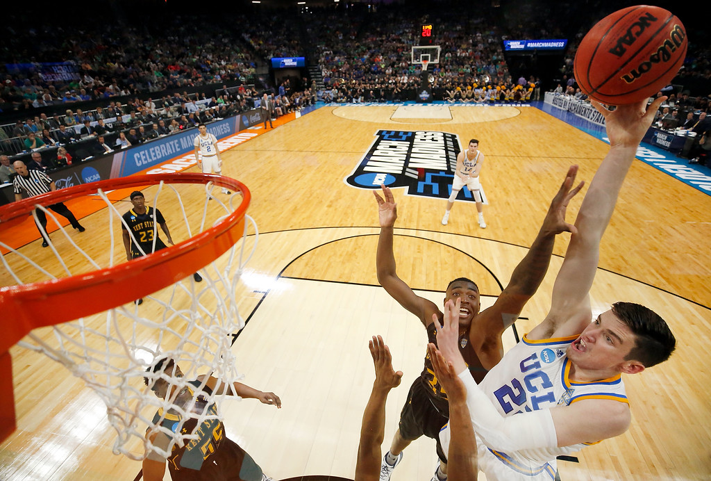 . SACRAMENTO, CA - MARCH 17:  T.J. Leaf of the UCLA Bruins shoots during the first round of the NCAA Basketball Tournament against the Kent State Golden Flashes at Golden 1 Center on March 17, 2017 in Sacramento, California.  (Photo by Thearon W. Henderson/Getty Images)