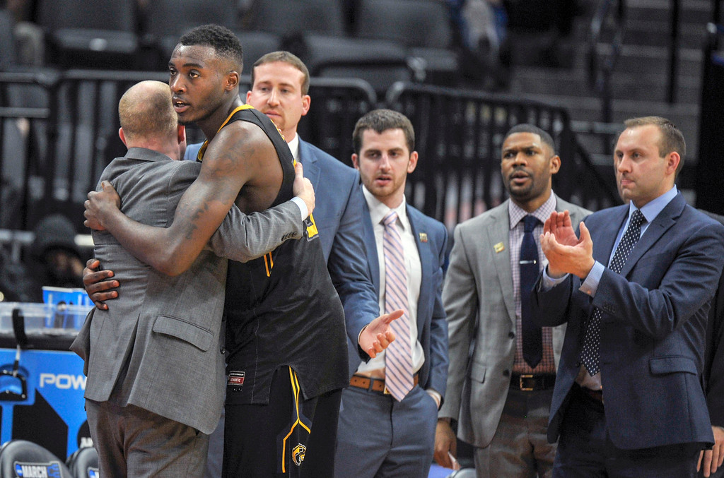 . Kent State head coach Rob Senderoff, left, hugs forward Jimmy Hall after he fouled out in the closing moments of Kent State\'s 97-80 loss to UCLA in a first-round game of the men\'s NCAA college basketball tournament in Sacramento, Calif., Friday, March 17, 2017. (AP Photo/Bryan Patrick)