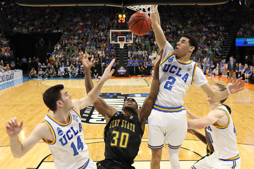 . SACRAMENTO, CA - MARCH 17: Deon Edwin #30 of the Kent State Golden Flashes attempts a shot defended by Gyorgy Goloman #14 and Lonzo Ball #2 of the UCLA Bruins during the first round of the 2017 NCAA Men\'s Basketball Tournament at Golden 1 Center on March 17, 2017 in Sacramento, California.  (Photo by Jamie Squire/Getty Images)