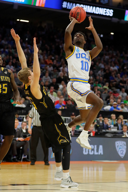 . SACRAMENTO, CA - MARCH 17: Isaac Hamilton #10 of the UCLA Bruins attempts a shot against the Kent State Golden Flashes during the first round of the 2017 NCAA Men\'s Basketball Tournament at Golden 1 Center on March 17, 2017 in Sacramento, California.  (Photo by Jamie Squire/Getty Images)