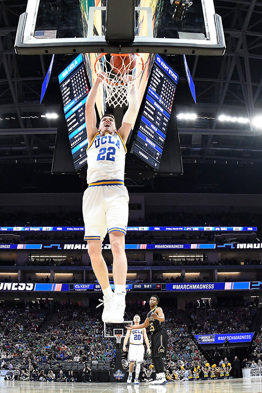 . SACRAMENTO, CA - MARCH 17: TJ Leaf #22 of the UCLA Bruins dunks the ball against the Kent State Golden Flashes during the first round of the 2017 NCAA Men\'s Basketball Tournament at Golden 1 Center on March 17, 2017 in Sacramento, California.  (Photo by Thearon W. Henderson/Getty Images)